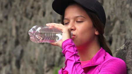 Thirsty Girl Drinking Bottled Water Stock Photo