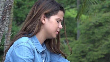 tearful: Hispanic Teen Girl Tearful With Emotional Pain Stock Photo