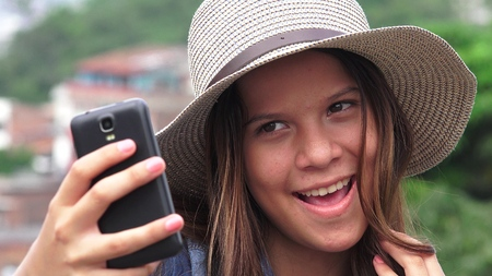 selfy: Adorable Teen Girl Making Selfies And Funny Faces