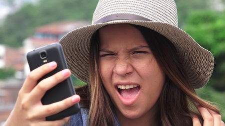 Adorable Teen Girl Making Selfies And Funny Faces
