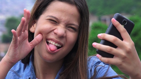 clowning: Silly Goofy Girl Making Funny Faces And Taking Selfy