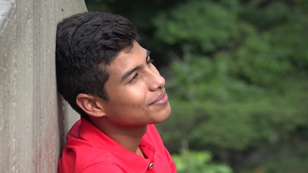 Hopeful Teen Boy Wondering Or Daydreaming