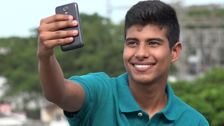 Smiling Teen Boy Taking Selfy Stock Photo