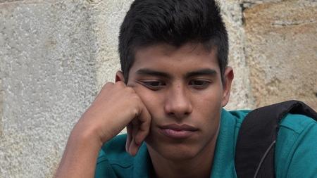 Sad And Unhappy Male Hispanic Teen