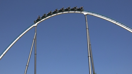 excite: Exciting Theme Park Roller Coaster Ride Stock Photo