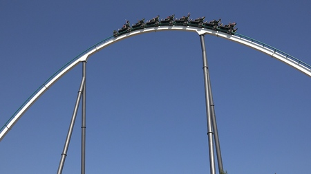 Exciting Theme Park Roller Coaster Ride Imagens