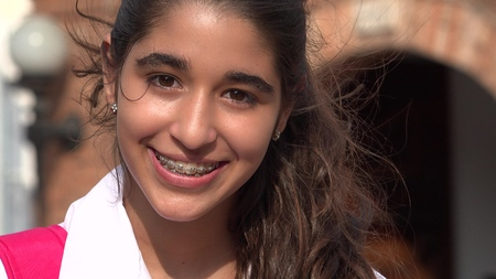 Pretty Teen Girl Smiling With Braces Stockfoto