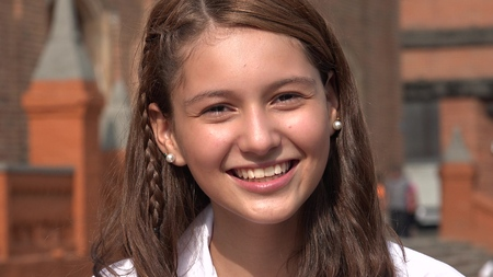 Smiling And Excited Teen Girl