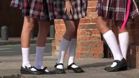 skirts: Girls With Skirts And White Socks Stock Photo