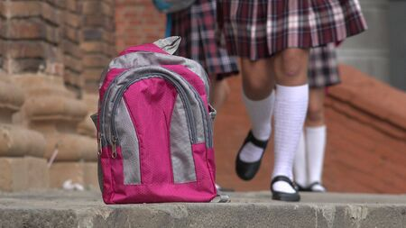 Female Student Forgets Backpack