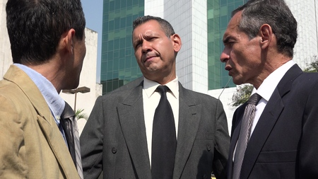 Confused Hispanic Business Men Stock Photo