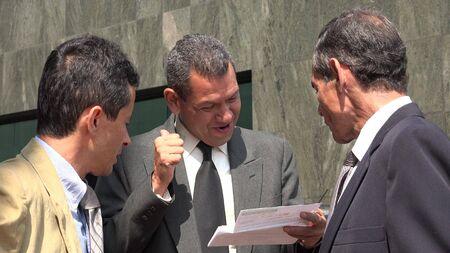 revisando documentos: Happy Business Man Reviewing Documents