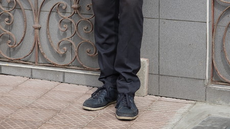 Feet And Legs Of Man Standing