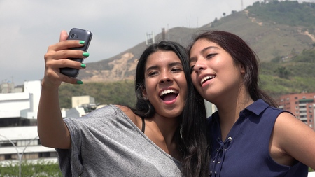 Teen Female Friends Taking A Selfie