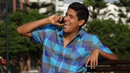 Happy Teen Boy Talking On Cell Phone