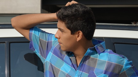 Confused Teen Boy And Car