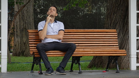 Man Sitting Alone In Park And Daydreaming