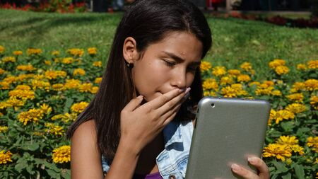 Confused Teen Using Tablet