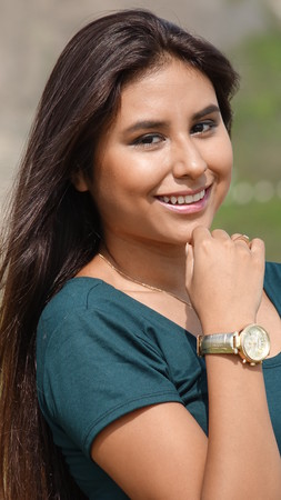 Teen Hispanic Female Wearing Watch