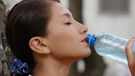 Teen Girl Drinking Water