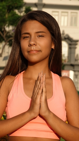 plead: Female Teen Yoga Or Prayer