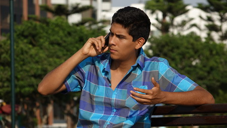 Confused Teen And Cell Phone