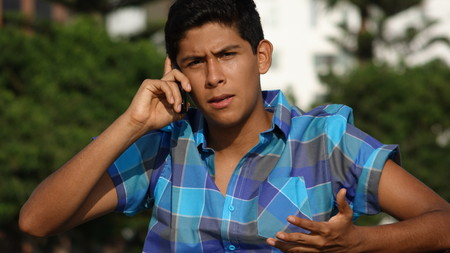 Teen Boy Confused Phone Call Stock Photo