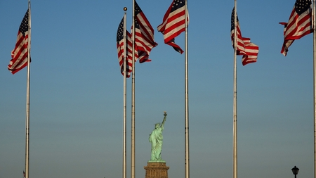 Statue Of Liberty And Us Flags