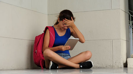 Stressed Or Confused College Student With Tablet Stock Photo
