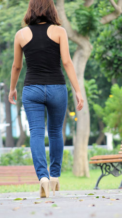 Cute Female And Beauty Wearing Blue Jeans Walking In Park