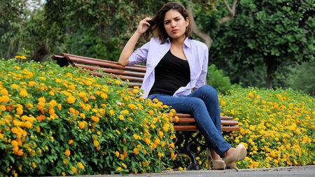 Anxious Teen Female Sitting In Park