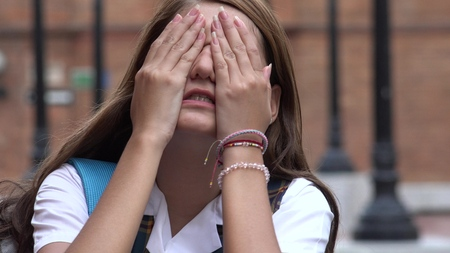 Stressed Female Teen Student Covering Her Eyes