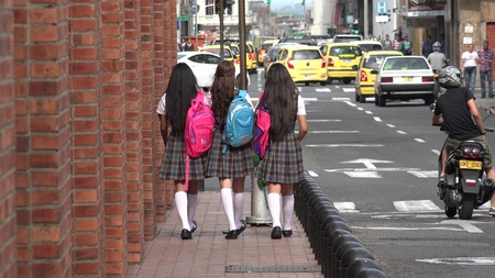 High School Students With Backpacks Stock Photo