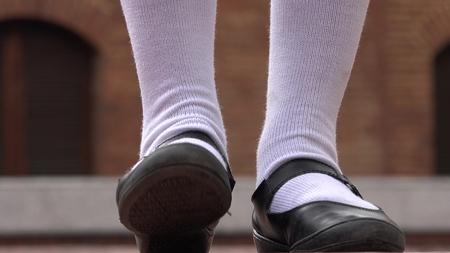 Girl Tapping Her Foot Wearing White Socks Imagens