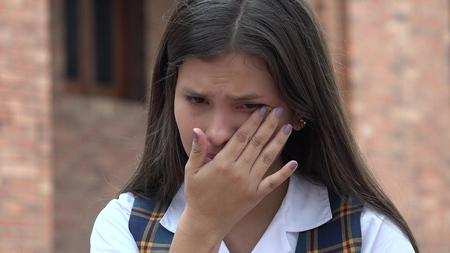 Sad Tearful Female Student