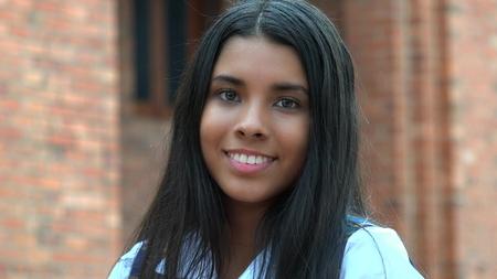 Smiling Hispanic Teen Girl And Happiness Stock Photo