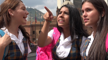 Surprised Or Confused Female Student Pointing