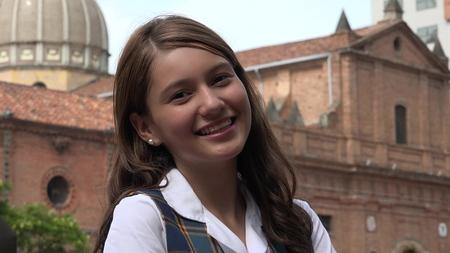 Smiling Teenage Girl Near Church