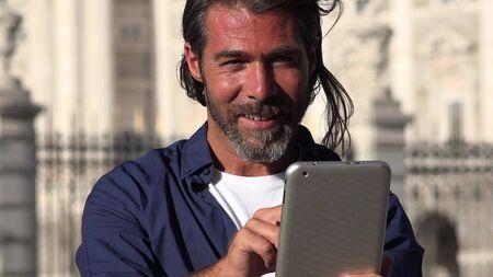 European Male Using Tablet
