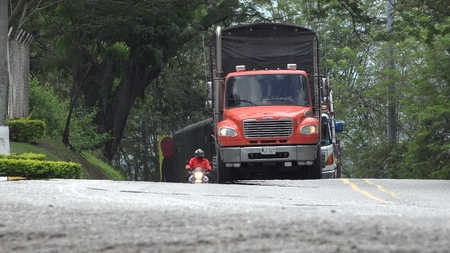 Delivery Truck Driving On Road Editorial