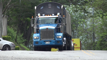 Blue Semi Truck Driving And Shipping Editorial