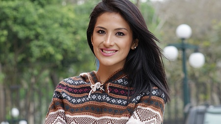 Smiling Hispanic Woman In Park Stock Photo