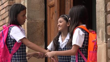 Girl Students Saying Goodbye Wearing School Uniforms