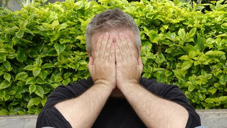 Ashamed Unshaven Caucasian Male Stockfoto