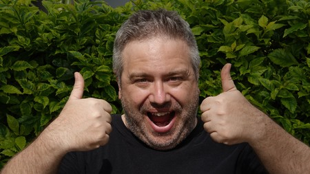 Unshaven Male With Thumbs Up