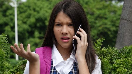 Girl Student Using Cell Phone And Unhappy Stock Photo