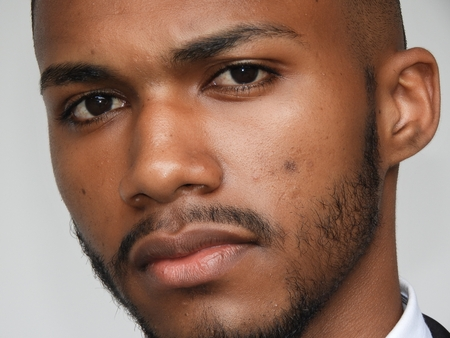 Serious Unshaven Black Male Stock Photo