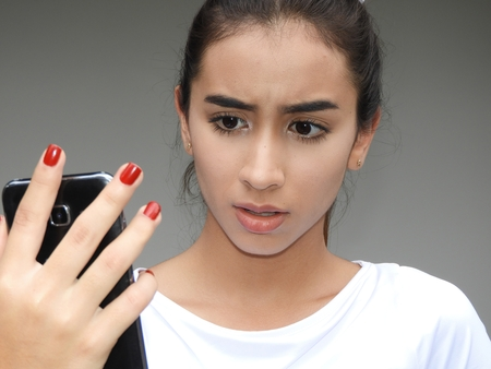 Pretty Girl Youngster Using Cell Phone And Unhappy