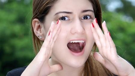 Pretty Female Teenager Shouting Stock Photo