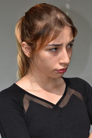 Unemotional Youthful Female Stock Photo